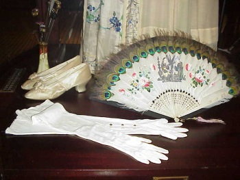 old fashioned fans and gloves